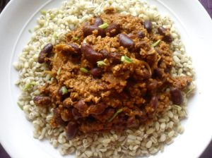 Chilli con carne served with barley
